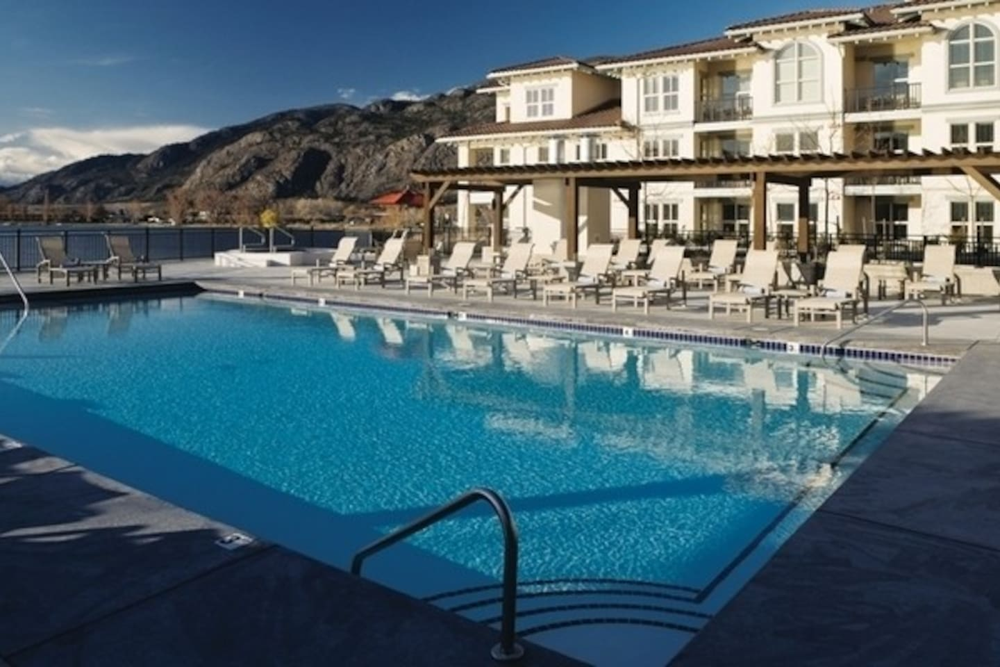 Bask in the sun by the outdoor pool, overlooking stunning Osoyoos Lake