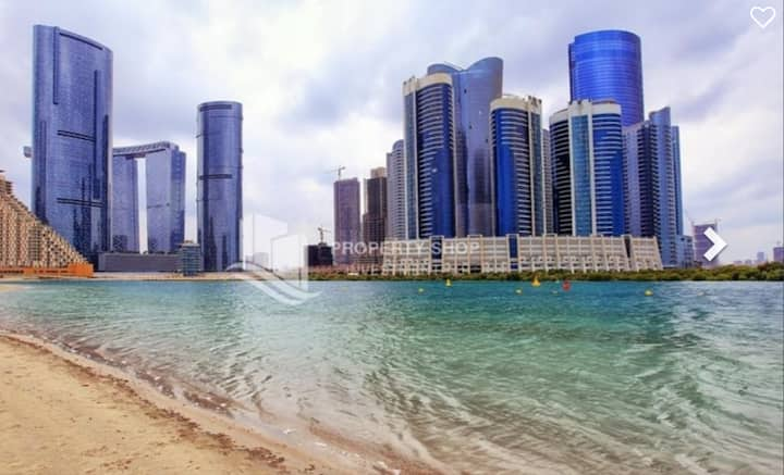 furnished bedroom with sea view in reem island