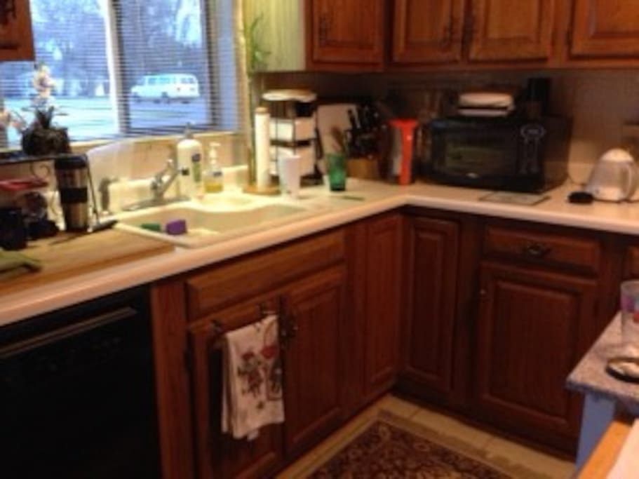 Kitchen with dishwasher, microwave