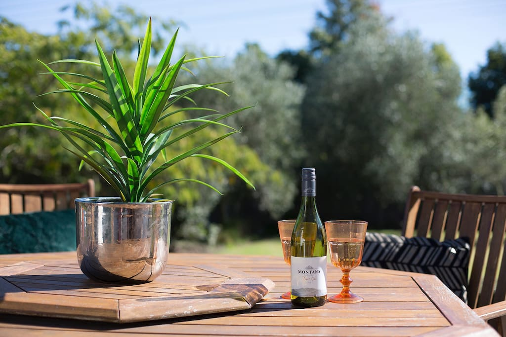 Enjoy a wine on the deck in the late afternoon sun