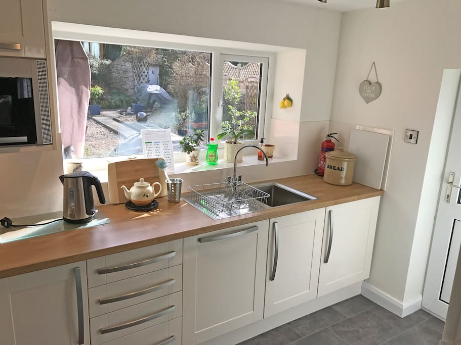 wine fridge . access to large enclosed rear garden . south facing