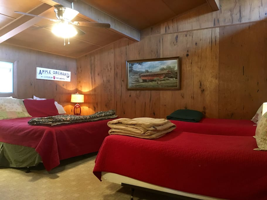 """Twin bed room made up with two of the twins as a """"pseudo-king"""" and a new ceiling fan/light"""