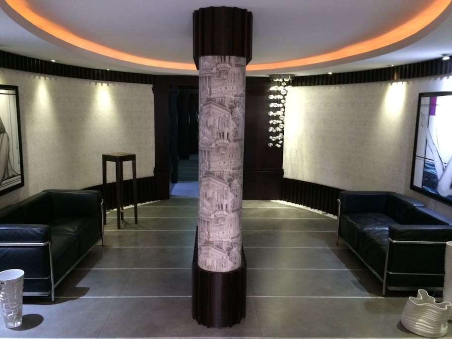Modern and Luxurious decor al around. Entrance to the building and access to elevator.