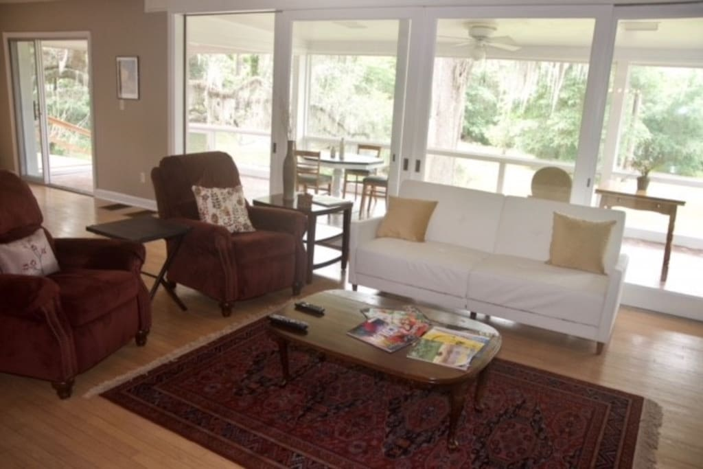 living room with large enclosed lanai behind