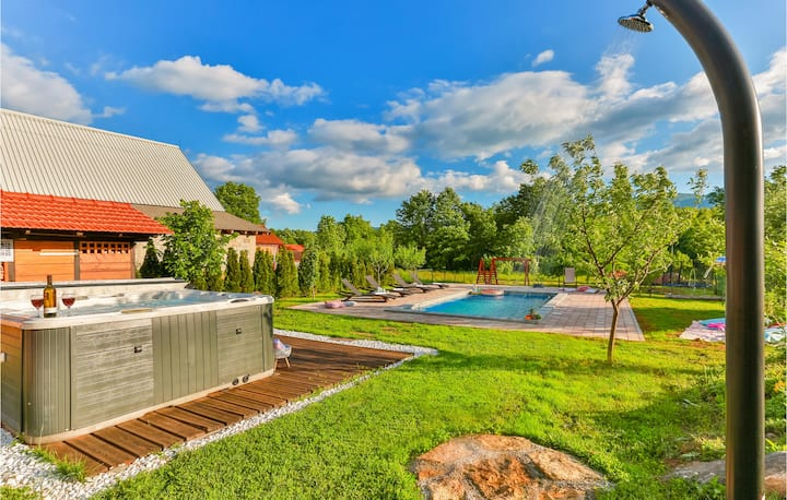 Awesome home in Lovinac with Outdoor swimming pool, Jacuzzi and 2 Bedrooms