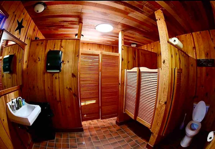 This is the men's room. Next to this is the ladies room both have hot and cold water and showers too. They are less then a minute walk from the Fish Camp residence.