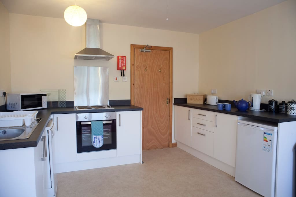 Fully equipped kitchen including dishwasher and micro wave.