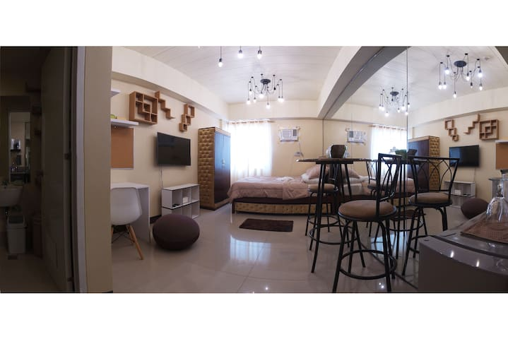 Complete studio condo unit with essential amenities.