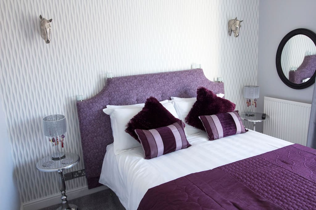 Ensuite Master bedroom - king bed overlooking canal