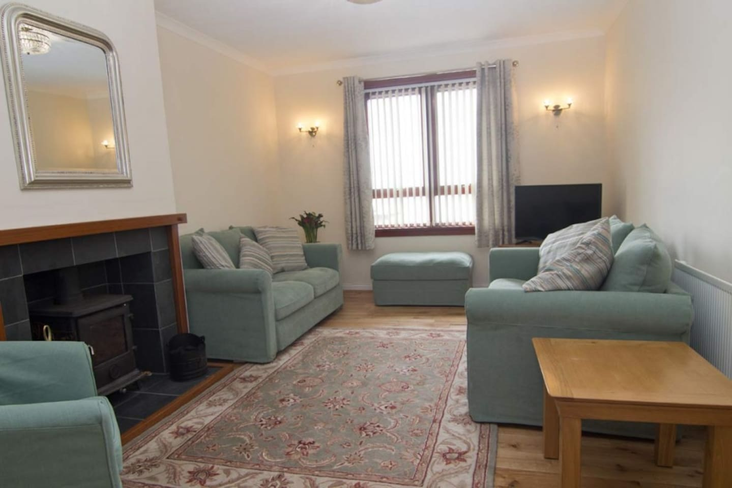 Cozy living area, overlooking sea to Isle of Skye and views to Mallaig Harbour. Aga stove.