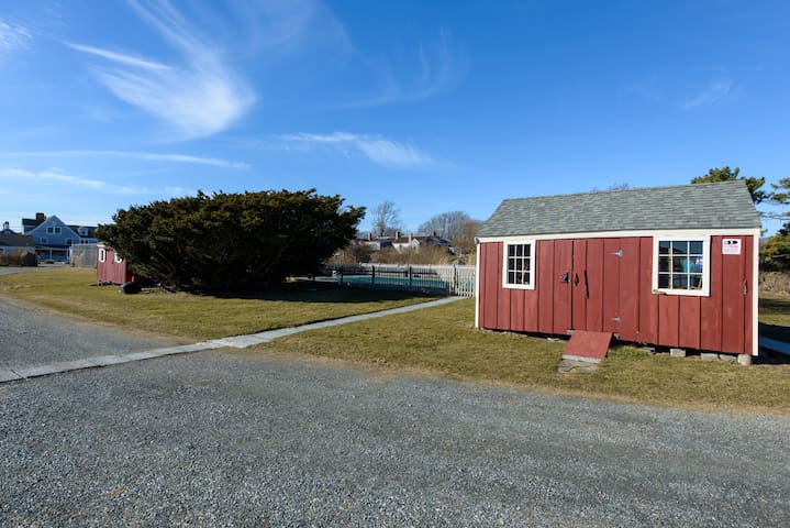 This storage shed and view of pebbled driveway, taken when turning away from ocean view.