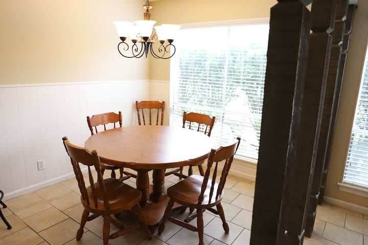 two leaves can be added there are 6 chairs, kitchen is complete, coffee maker toaster, blender, mixer, pots pans, dishes ,silverware and baking stuff. microwave, stove ,refrigerator ,