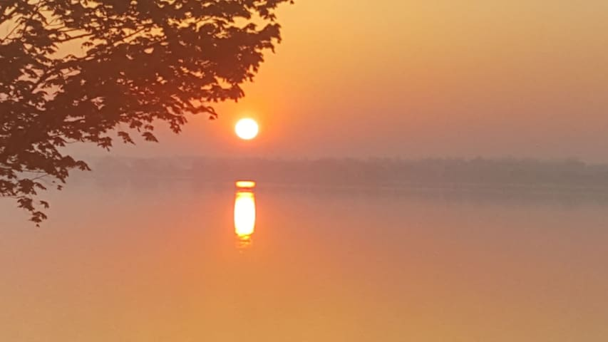 Sunrise over misty lake