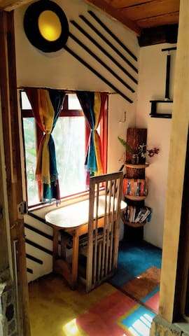 desk and bookshelf inside the room