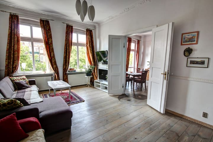 Classic living in a historical building. High ceilings, wooden floors and original wooden stucco.