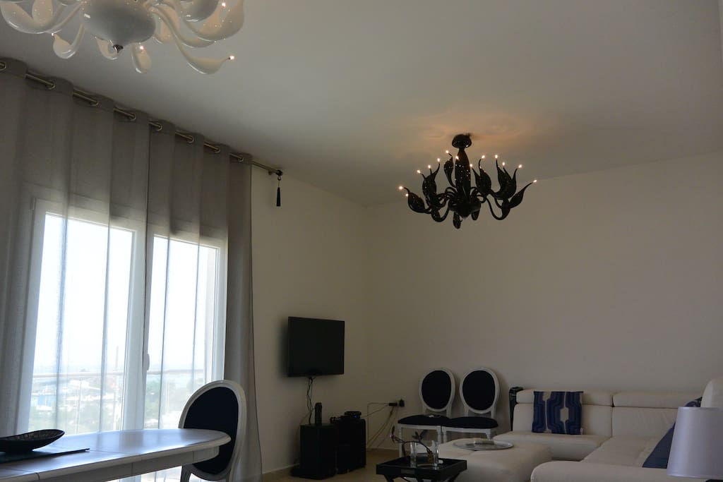 living room with sea view balcony, large sofa, dining table sitting 6 people
