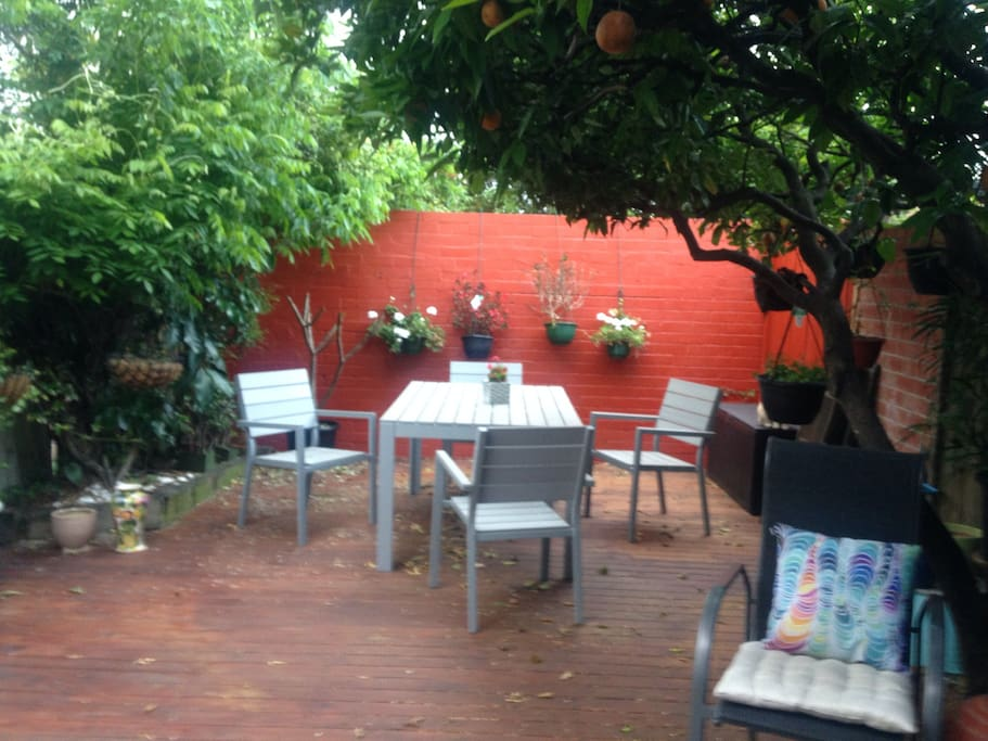 A lovely spot to relax on long summer evenings. The orange tree provides plenty of shade.