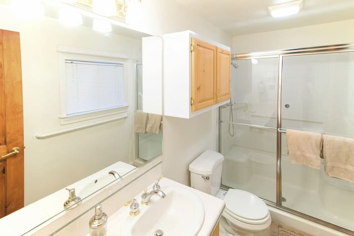 The third bathroom offers a large shower.