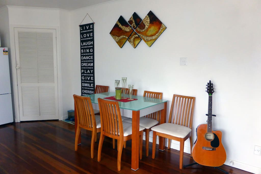 Dining table, plenty of room to spread out. An opportunity to all eat at the table.