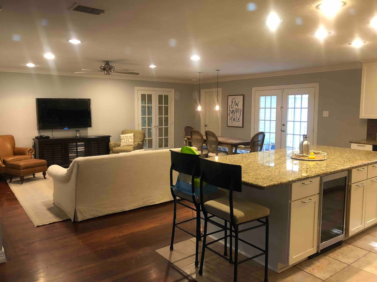 Enjoy cooking in the gourmet kitchen while having a direct view past the French doors into the movie room/playroom.
