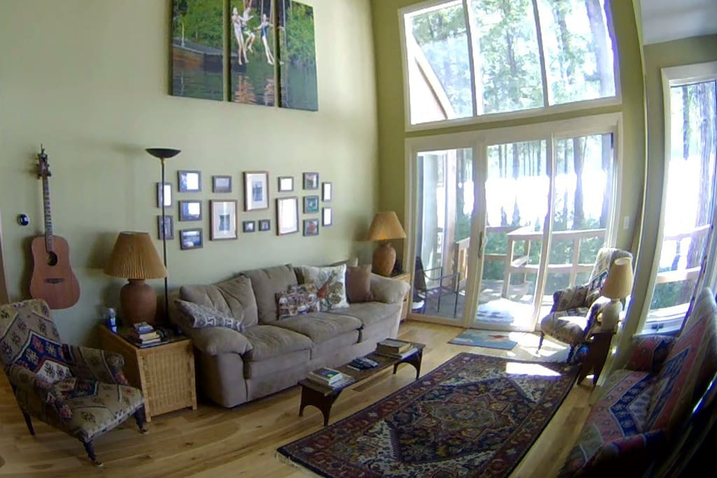 Wide angle view of family room - very light - a great space, views incredible.  That white horizontal line outside is the lake in winter, reflecting.