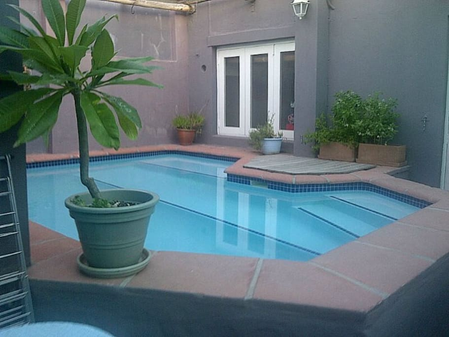 Sparkling pool area with secure garage/parking & remote access