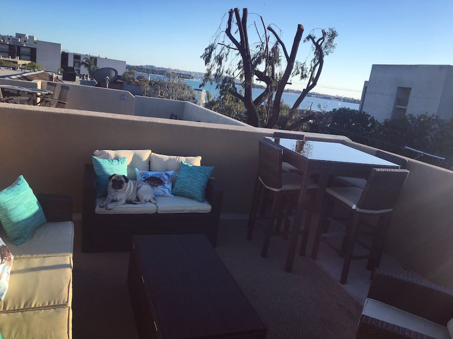 New patio furniture with a view of the bay from our roof!