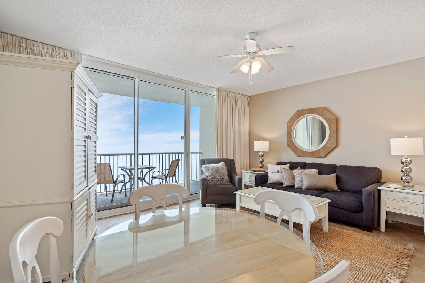 Large living area with ocean views and comfortable queen memory bed pullout