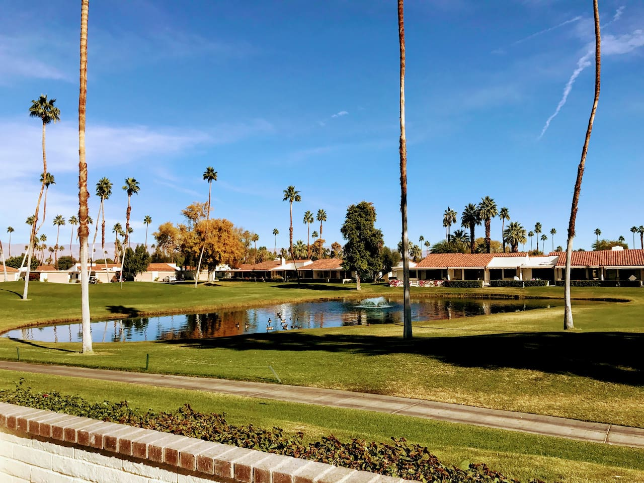 Relax on the peaceful patio on the fairway at Rancho Las Palmas Resort