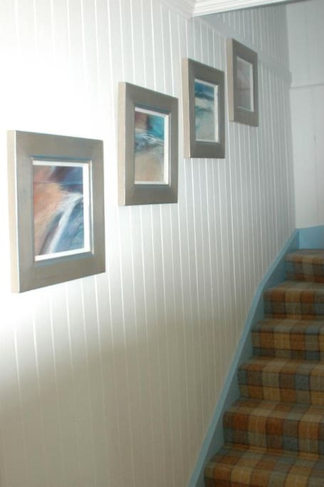 Original artwork leads you up the stairs.