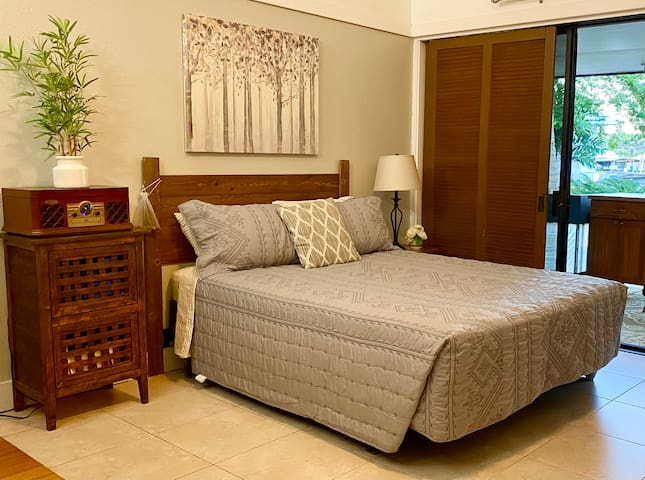 Queen size bed with provided linen allows for a restful night's sleep. Plantation shutters can be completely closed to block out daylight for those working night shifts.