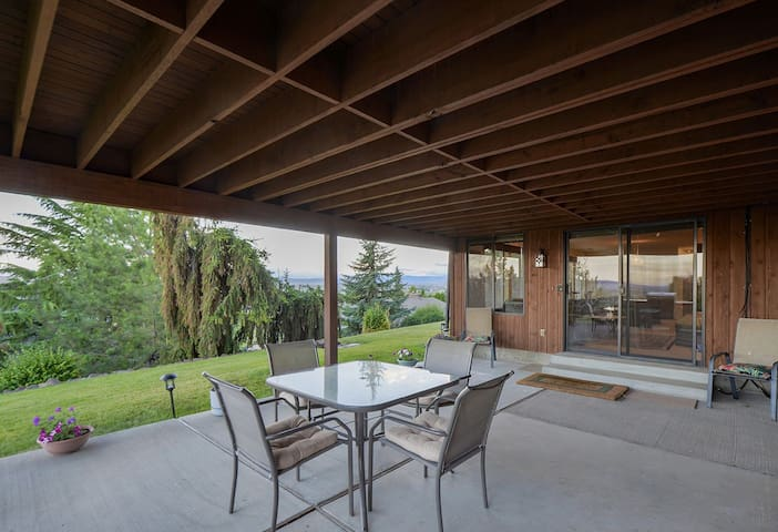 Your private covered patio with dining table for four, a sitting area and BBQ