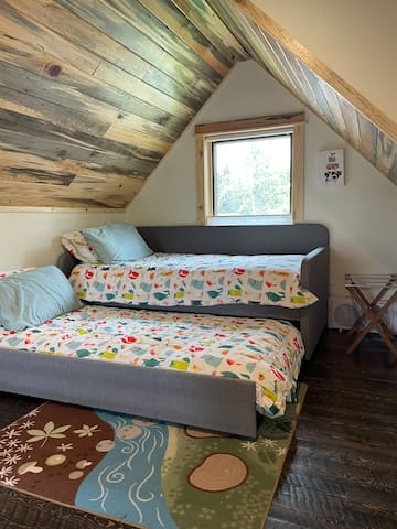 Trundle bed in loft.