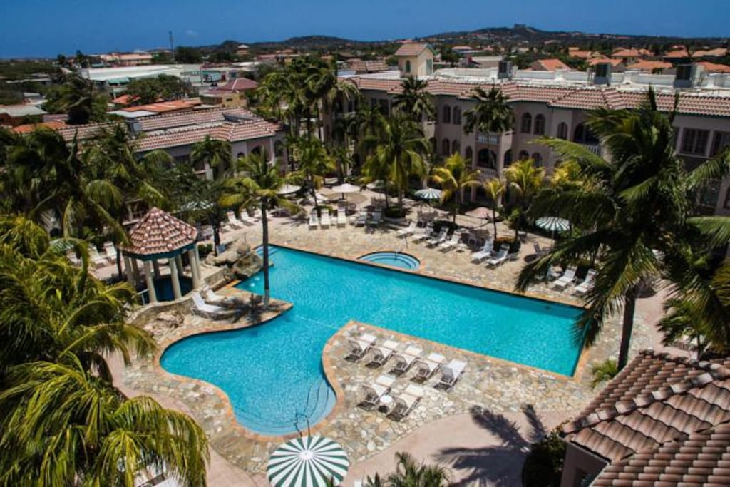 """An overhead view of the resorts """"Back Pool""""  & 8 person jacuzzi.. One of the two pools located on opposite ends of the resorts courtyard."""