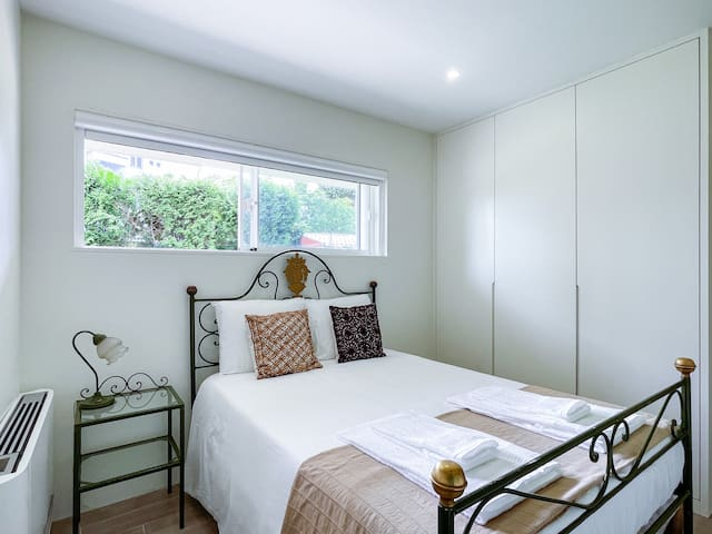 double bedroom with couple size bed