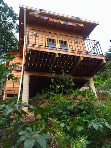 Front view of cabin with front porch.