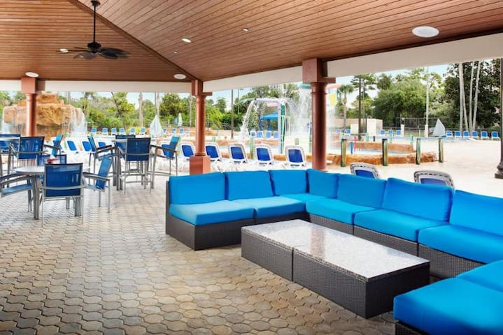 Covered poolside lounge area w/ comfy furniture!
