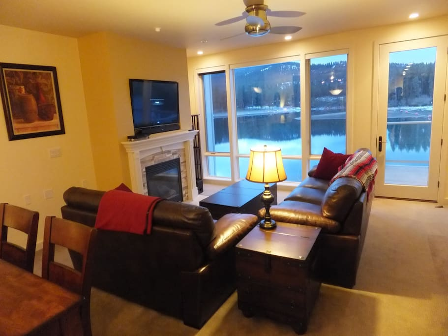 """Living room area with HD 48"""" TV and gas fireplace."""