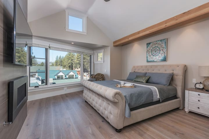 The private master suite with vaulted ceilings and a gas fireplace provides the perfect place to unwind.