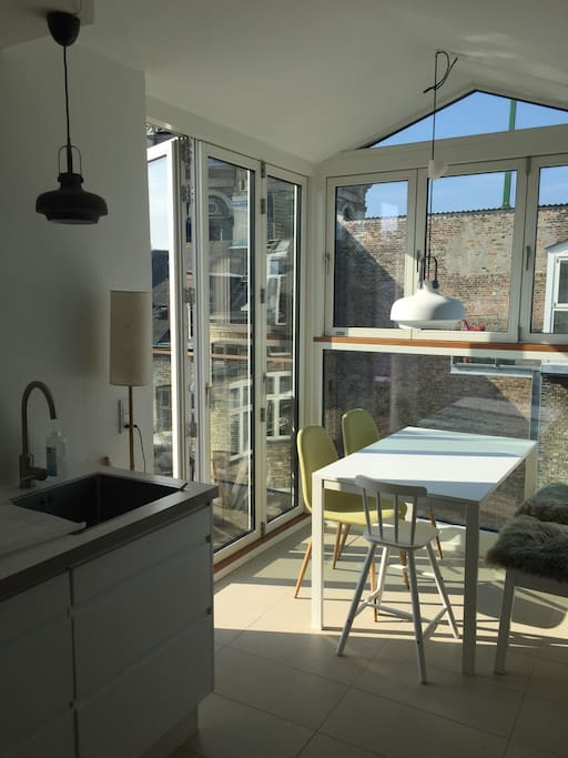 Kitchen with access to private balcony, just in front of the marble church