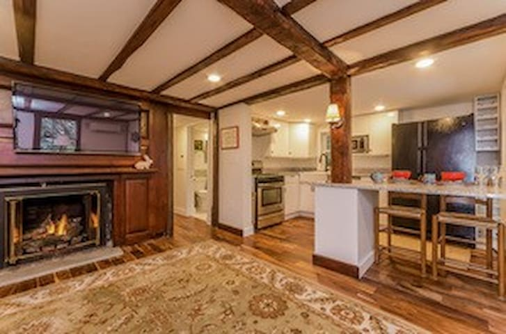 Spacious, fully renovated living room with original 18th century details.