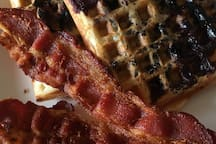 Homemade Blueberry Waffles Served With Either Crisp Bacon Or Sausage And Whip Cream.  Enjoy On Your Private Balcony Or Poolside.