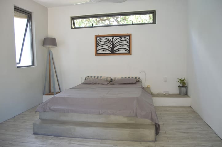 Master bedroom with view of the external bathroom.