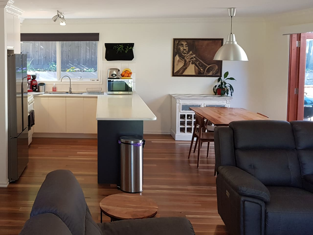 Open plan kitchen, dining and lounge with doors leading out to your prime deck