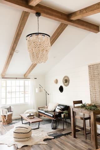 Vaulted living room with exposed beams.