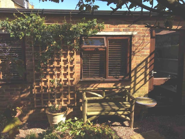 Private, secluded area of our garden designed for your use.  There is a door leading out from the studio.