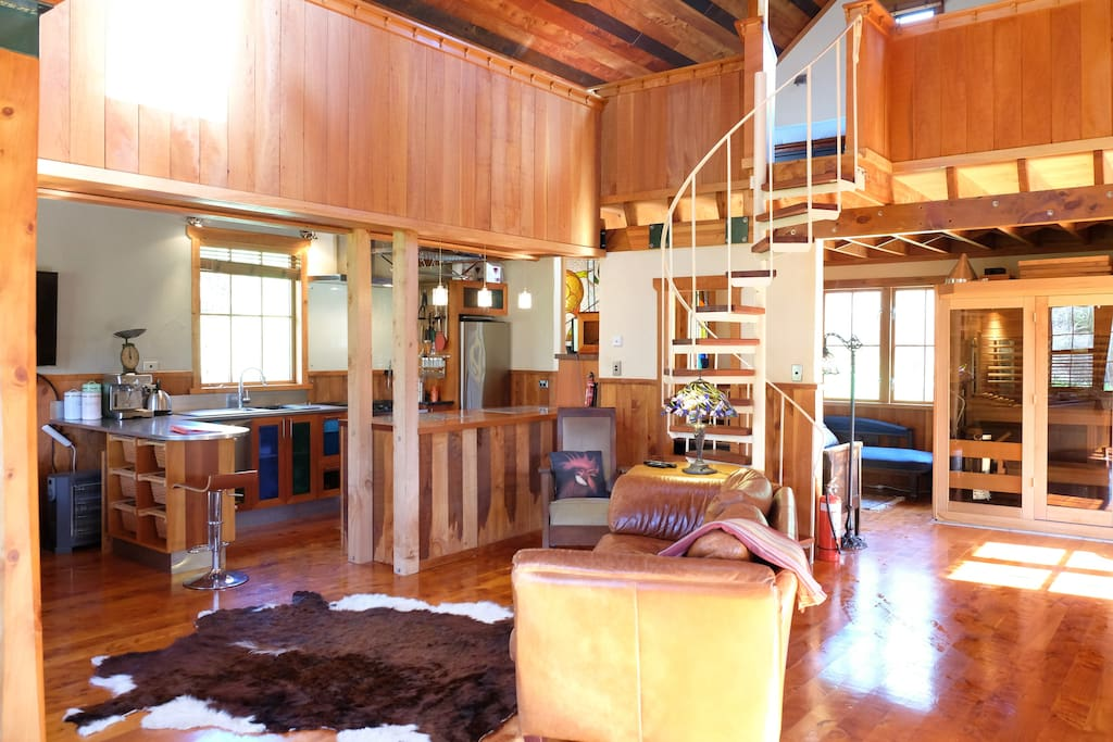 The cabin has rough sawn macrocarpa wainscotting, timber floors and a loft bedroom
