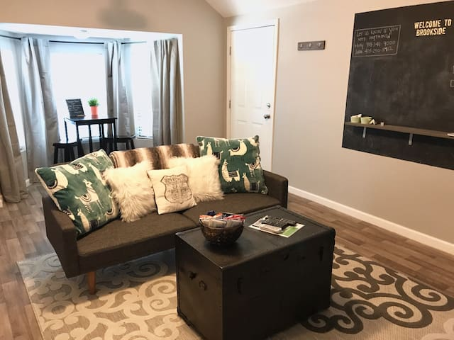 Enjoy provided snacks and binge a show on our modern couch. The couch folds down into a full-size bed, and we have sheets and blankets for two extra people to crash on the couch.