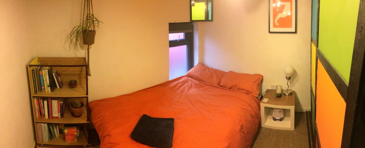 Brightly coloured double bedroom