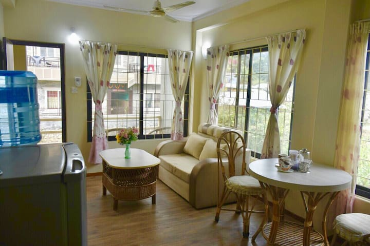 Living and dining area with refrigerator, drinking water dispenser...